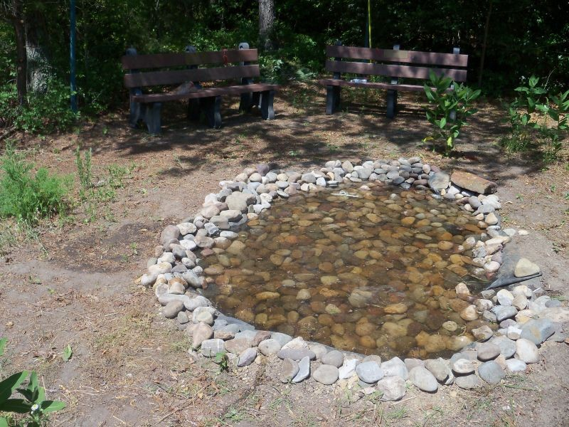 Small pond made with large smooth rocks